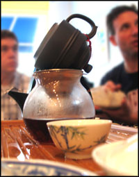 Decanting the pu-erh into a serving pitcher.