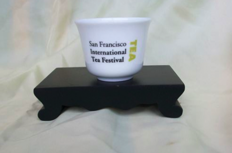 SF Tea Festival cup on wood stand